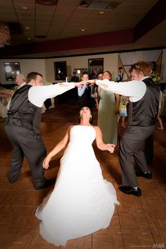 Bride limbos under groomsmen during reception #Michiganwedding #Chicagowedding #MikeStaffProductions #wedding #reception #weddingphotography #weddingdj #weddingvideography #wedding #photos #wedding #pictures #ideas #planning #DJ #photography