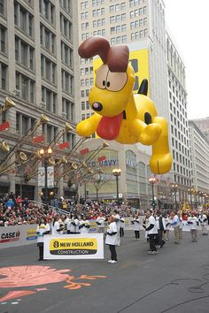 Odie is from Jim Davis's comic strip Garfield and first appeared in 1978. Though it may not seem obvious, Odie is one of Garfield's best friends.     In 2011 (pictured here), Odie was presented by New Holland Construction.