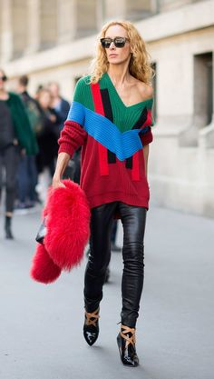 Elina Halimi How to make leather leggings and a sweater not look basic? Have the sweater casually slide off the shoulder and carry (but not wear!) a super-luxe red fur stole.  Photo: YoungJun Koo/I'M KOO