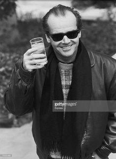 American actor Jack Nicholson raises a glass, 1984.