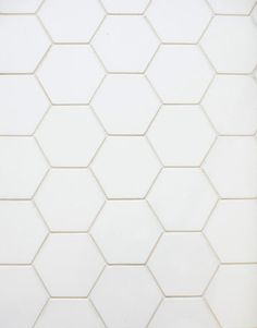 Thassos marble on the floor, in the form of four-inch hexagonal tiles from Waterworks...with black grout...one day, one day