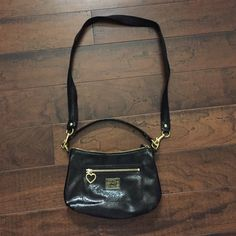 Coach Poppy patent leather bag Versatile bag! Can be worn on shoulder or as a cross body. Front zip pocket and inside small zipper pocket. Great condition! Coach Bags Crossbody Bags