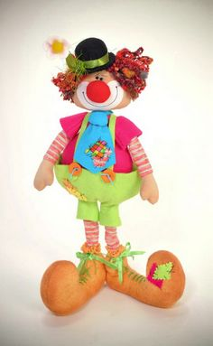 *SORRY, NO INFORMATION as to the material that was used.  Clown tutorial + pattern