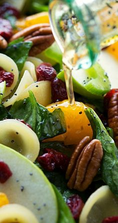 Autumn Crunch Pasta Salad ~ A simple pasta + spinach salad with crunchy apples, celery, and toasted pecans, chewy dried cranberries, sweet mandarine oranges and coated in a delicious poppyseed vinaigrette.