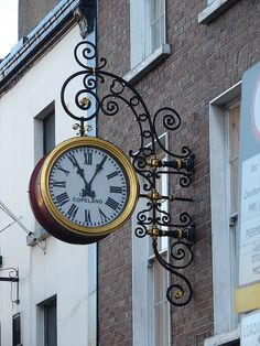 Dublin Ireland clock by Miguel Angelo wonder if this is at a jewelry store, bank? I wish US towns had descriptive signs in front of businesses like other countries do, so beautiful and fascinating to see.