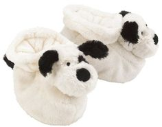 Baby booties featuring cream colored dog with black ears, tail, and spotted eye. The Jellycat Bashful plush toys have been incredibly popular, and now they bring that same wonderfully soft and soothing texture to booties. Not only do they look adorable, they keep babys feet warm, and provide a fun tactile experience when babies starts play with their feet. Makes a lovely gift for a newborn.