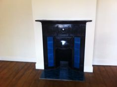 Blue 1930s tiled fireplace in main bedroom
