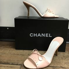 BNWB Chanel Pink Mules Brand new with box! Never worn. Authentisity card has not even been taken out of envelope. Purchased from Neiman Marcus. Size 38/8. Retails for $465. Beautiful pastel pink color with cute cutout and bow details. Comes with original box and dust covers.  **please note this item is also for sale in our store, please ask if still available before purchasing!** CHANEL Shoes Mules & Clogs