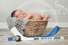 Newborn with Hockey Sticks by Shadeleaf Studios, via Flickr