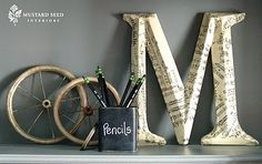"""used some vintage sheet music to cover a large """"M."""""""