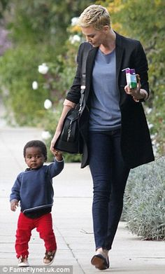 Charlize Theron..Love!!!..What a cutie: The one-year-old looked adorable in his fire engine red trousers as he walked along with his famous mum