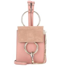 Chloé - Faye Mini Bracelet leather and suede bag - Chloé keeps up with the mini craze of the moment with the 'Faye Mini Bracelet' style. This adorable, downsized design comes in rosy pink leather with a suede flap and mixed-metallics hardware for that polished finished. Hold it by the wrist strap against evening ensembles or go cross-body for daytime chic points! seen @ www.mytheresa.com