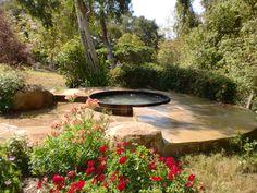 Lovely hot tub set in flagstone. www.gordonandgrant.com