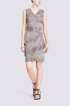 BLYTHE SUEDE DRESS  WITH FRINGE: Supple suede makes a forceful yet understated statement in this figure-flattering silhouette. Hand-rendered whipstitching and laser cut details give this fringed dress a dramatic impact.