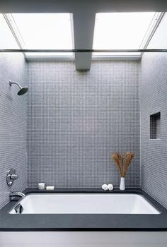 Black and grey and a deep tub/shower combo.