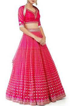 Featuring a pink sleeve less long kurta crafted in silk with embroidery of gotta, dori, zardosi, pearl and zari handwork. It has a tie up detailing on the side. It comes along with a matching lehenga skirt and net embroidered dupatta. Fabric: Silk, Net Care Instructions: Dryclean only.