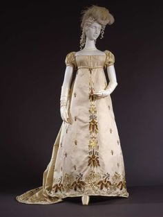 Gala dress in silk diagonale fabric, with embroideries in coloured chenille and silk thread and gold tinsel differently shaped, gold paillettes in floral motifs; French manifacture,1804-1808. Collection Galleria del Costume di palazzo Pitti. All rights reserved. Photo: Marcello Bertoni
