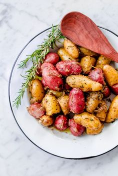 Braised Fingerling Potatoes with Garlic, Shallots, and Fresh Herbs. A cozy, easy-to-prepare side dish recipe for fall!
