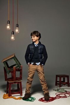 Boys brown chinos, worn with a navy sweater and smart shirt.