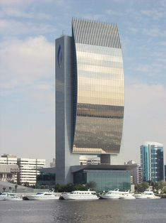 This Is Another Picture Of A Building With Interesting Architecture Located In Dubai, United Arab Emirates- National Bank Dubai Buildings, Unusual Buildings, Interesting Buildings, Amazing Buildings, Modern Buildings, Skyscrapers, Futuristic Architecture, Beautiful Architecture, Contemporary Architecture