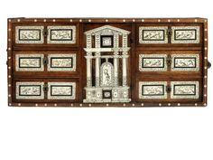 An Italian late 17th century ivory inlaid walnut table cabinet 96cm wide, 29cm deep, 43cm high (37 1/2in wide, 11in deep, 16 1/2in high).