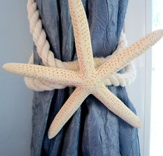 Beach decor starfish tie back for curtains. This nautical decor starfish curtain tieback is perfect for your beach house! Made of thick nautical roping holding a perfect white finger or brown sugar starfish, it just oozes personality and beachiness!!  I made these for my home and liked them so much I decided to offer them to my beach-loving customers! This beach decor starfish tie-back is made of real nautical roping, with a perfect 4-6 sugar, brown knobby, white jungle, or white finger…