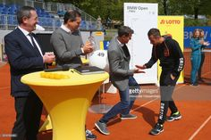 Philipp Kohlschreiber (R) of Germany attends with Tournament Director Patrick Kuehnen (2nd R) the draw for the 102 on April 29, 2017 in Munich, Germany. BMW Open by FWU at Iphitos tennis club in Munich, Germany.