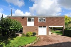 This three-bedroom house in the historic village of Langley, Kent, was designed in the early 1970s by the architect Patrick O'Keefe. It is an excellent example of Mid-Century Modern architecture, featuring large picture windows that flood the living room with light and offer fantastic views over the surrounding open countryside. The first floor features an […]