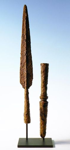 Greek iron spear point and buttspike (sauroter). The blade is elongated leaf-shape design with a central mid-rib, sauroter is thickly cast, terminating in a solid point. Ca. 550-400 BC. H. 35 cm. The sauroter (the Greek word sauroter literally meant 'lizard killer') served as a counterweight to the spear point. It also allowed the spear to be lodged into the ground at an angle to form a defensive formation. In the event that the spear broke, it was often turned to as a weapon of last resort.