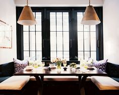 love the high contrasts and practicality of this kitchen nook