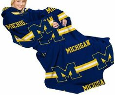 NCAA Michigan Wolverines Comfy Throw Blanket with Sleeves, Stripes Design by Northwest. $19.99. polyester. One Size Fits Most Adults; Measures 48x71. Bold Team Graphics. Officially Licensed. Machine Washable. 100% Polyester. Made of soft, thick, luxurious fleece with oversized loose fitting sleeves, the Comfy Throw, Officially Licensed Blanket by Northwest™ lets shoulders, arms and upper body remain protected from the cold while leaving arms and hands free to us...