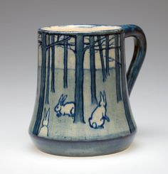 """Mug with rabbits in a forest design, ca. 1902, by Amelie Roman and Joseph Meyer. Collection of Caren Fine. On view in the Smithsonian traveling exhibition """"Women, Art, and Social Change: The Newcomb Pottery Enterprise."""" #arts #crafts #pottery #newcombpottery http://www.sites.si.edu/exhibitions/exhibits/newcombPottery/index.htm"""