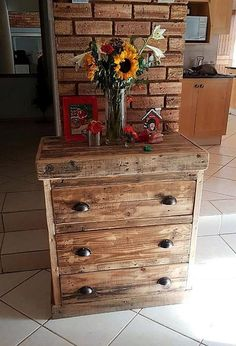 It is an ingenious idea for the decoration in the TV launch; the pallets can be reshaped into a wooden pallet table with drawers if there is a need of something to place the decorative items as well as for storing the items like TV remote in the TV launch.