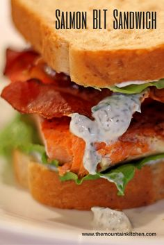 By adding salmon, you can turn a classic BLT sandwich into a quick and easy dinner in less than 30 minutes! Juicy ripe tomatoes, crisp lettuce, salty bacon, and a tender flaky salmon fillet with a tart and tangy yogurt dill sauce between two slices of honey wheat bread.
