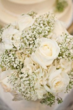 simply flowers - so classic - baby's breath, hydrangea, roses - round low vase so as to not overwhelm an already overwhelmed table. #kirstenboehmer.com