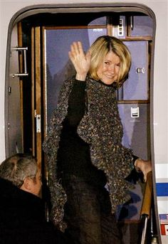 """Martha Stewart, CEO of Martha Stewart Living Omnimedia, waves as she boards her jet at Greenbrier Valley Airport in Lewisburg, W. Va. upon her release from prison March 4, 2005,  The determined, """"iconic promoter of the domestic arts"""" and her emphasis on craftsmanship & perfectionism across many fields has inspired entrepreneurs, home cooks and craftspeople for decades."""