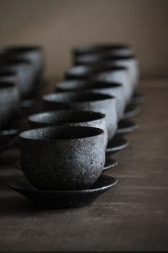 black on black tea cup with saucer