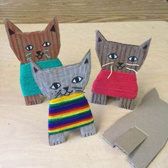 Cardboard Kittens. Students that may not be ready for weaving can have fun wrapping yarn to make a sweater for their kitty. #cardboard #catsdiycardboard