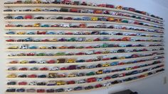 diecast car display - several six foot long pine boards, along with some 3 inch nails. Then I hammered the nails into my wall, put the boards on top of them, and added my toy cars.