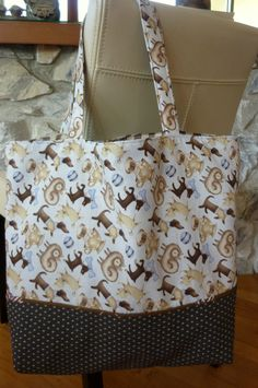 Tote bag features Debbie Mumm designer fabric for any dog lover.  Look for this bag at Caroline's Purse and Accessories sale Saturday, July 8, 2017.