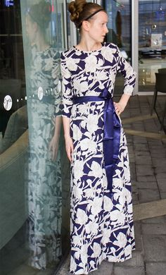 Cherry is a navy and white floral print maxi dress with 3/4 sleeves and matching navy ribbon belt