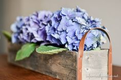 flower centerpiece made from fence slats. So easy to make!