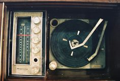 Looks like our old record player, a huge buffet big piece of furniture with the speakers, radio and turntable all inside