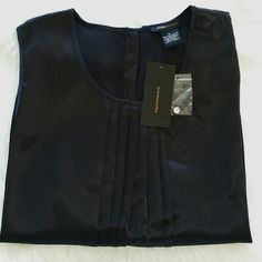 "SALE Bcbgmaxazria Black Dress Tank Top Gorgeous Bcbgmaxazria Black Dress Tank Top Pleated in front 2 diamond buttons on back 25"" from top of shoulder to bottom 20"" from armpit to armpit. Brand New BCBGMaxAzria Tops Tank Tops"