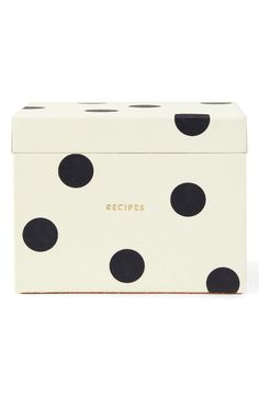 Signature polka dots pattern this charming Kate Spade recipe box filled with blank recipe cards and printed divider tabs.