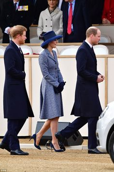 The Duchess of Cambridge, 35, recycled a favourite Michael Kors coat for the THIRD time as she joins the royals to unveil a new war memorial in London.