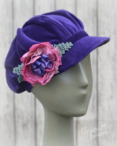 A handmade Velvet Newsboy hat by Jaya Lee Designs. This hat is made from vintage jewel tone purple cotton velveteen and is lined in black satin