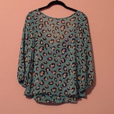 Spotted Blouse Turquoise blouse from boutique. Bow detail in back. Worn once! Tops Blouses