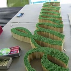 I think this looks like your grass idea. You could do it with your initials for the wedding, then LIGHT IT ON FIRE.