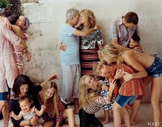 All in the Family - The Richards clan at home on Parrot Cay. Counterclockwise from far left: Marlon and wife Lucie de la Falaise; Angela, Ava, and Ella, in a Marc Jacobs top; Theodora, in a Saint James striped shirt and Marc Jacobs pants; Ida, Orson, and Alexandra; Graham Whitney and son Adam; Patti Hansen (in an Etro shirt) and Keith.  Fashion Editor: Camilla Nickerson